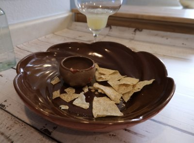 An empty bowl of chips and salsa