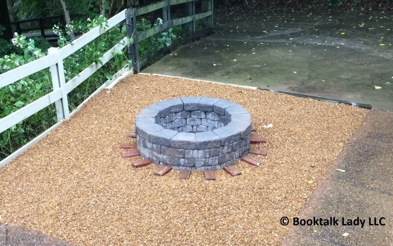 Fire pit with book talk lady