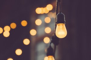 This is a picture of a light bulb shedding a soft, golden light.